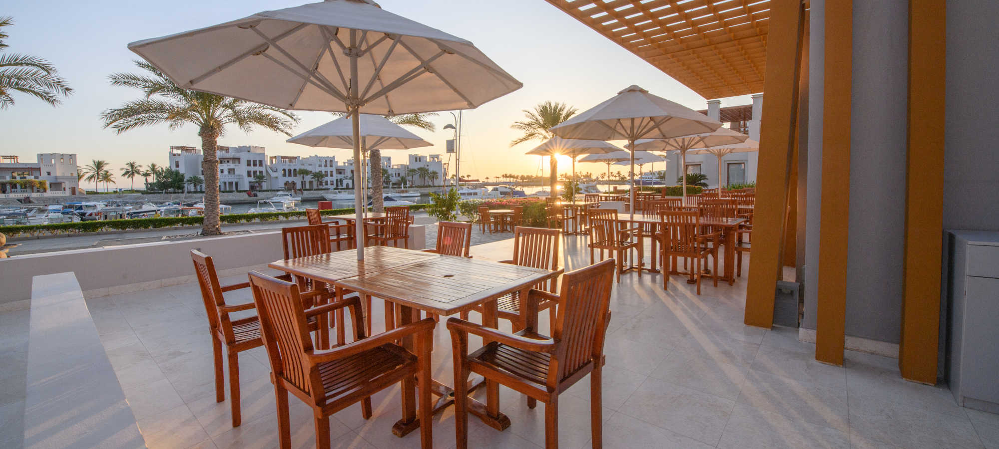marina view restaurant in sifawy hotel jebel sifah resort with yachts at day view
